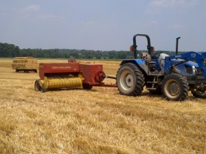 Baler in straw field