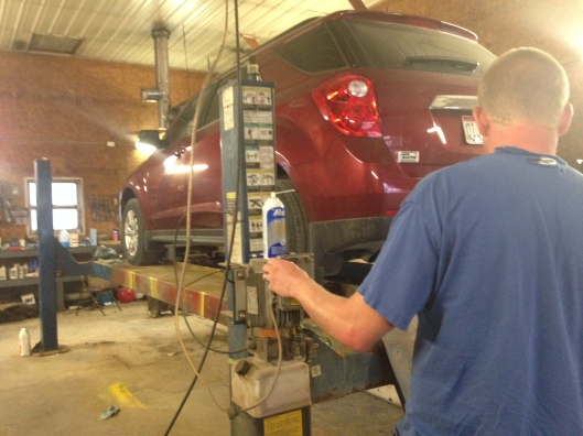 chevy equinox on lift in shop